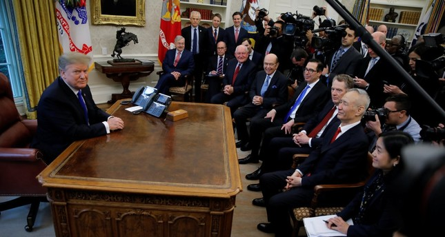 U.S. President Donald Trump meets with Chinese Vice Premier Liu He (R) in the Oval Office at the White House in Washington, U.S., Feb. 22, 2019.