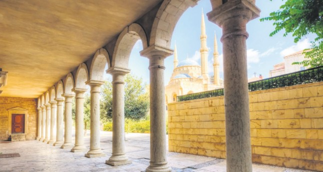 The Mohammad Al-Amin Mosque situated in downtown Beirut, Lebanon as viewed through the pillars of the Greek Orthodox church of St George.