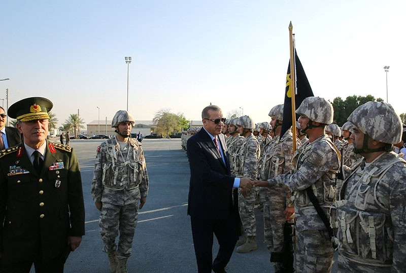 President Recep Tayyip Erdou011fan, accompanied by Chief of the General Staff Hulusi Akar, reviews Turkish troops during his visit at Qatari-Turkish Armed Forces Land Command Base in Doha, Qatar, Nov. 15, 2017. (Kayhan u00d6zer / Presidential Photo Service)
