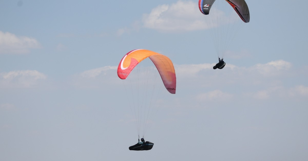 Paragliders soar in the sky after jumping from Mount Ali, Kayseri.