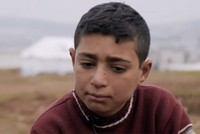 Displaced Syrian boy without jacket shows tragedy of refugees amid freezing temperatures