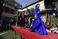 More than two dozen young models, including six women, walked down the runway in the garden of a private Kabul villa. Amid tight security, they proudly displayed the traditional clothing and...