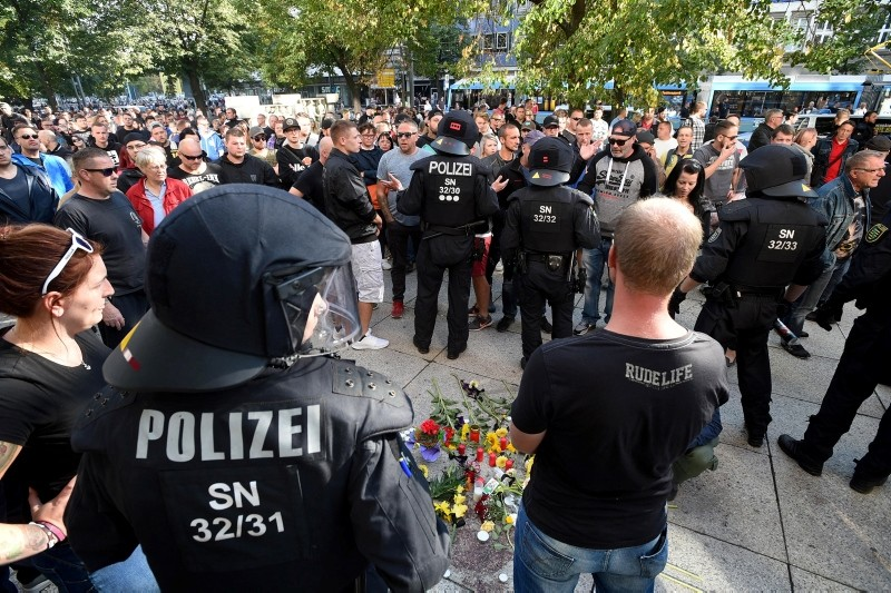 People gather and lay flowers at the place where a man was stabbed in the night of the 25 August 2018, in East German city Chemnitz, Germany, 26 August 2018 (issued 27 August 2018). (EPA Photo)