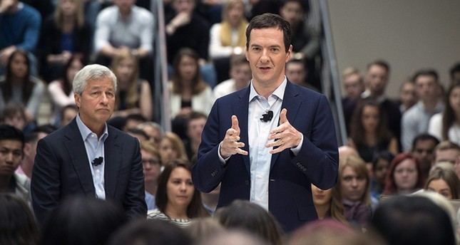 Chancellor of the Exchequer George Osborne (R) speaks with JP Morgan CEO Jamie Diamon (L) during an event on the United Kingdom's membership of the European Union (EU) in Bournemouth, Britain, 03 June 2016. (EPA Photo)