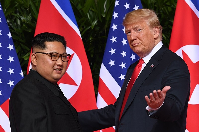 File photo taken June 12, 2018, shows U.S. President Donald Trump with North Korea's leader Kim Jong Un (L) at the start of their U.S.-North Korea summit, at the Capella Hotel on Sentosa Island in Singapore. (AFP Photo)