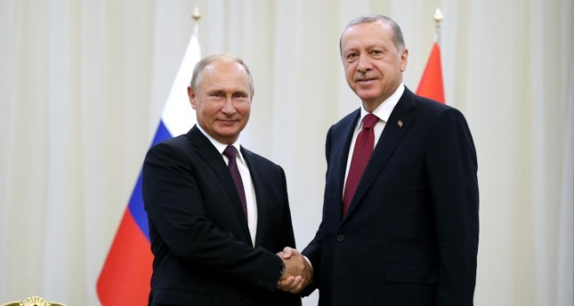 Turkey's President Recep Tayyip Erdoğan right, shakes hands with Russia's President Vladimir Putin, in Tehran, Iran, Friday, prior to their talks, part of Russia-Iran-Turkey summit to discuss Syria, Friday, Sept. 7, 2018. (AP Photo)