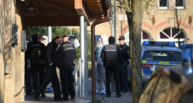 German police, including forensic experts stand at the entrance of a house after a shooter, believed to have a personal motive, launched an assault on January 24, 2020 in the town of Rot am See in southwestern Germany. AFP Photo