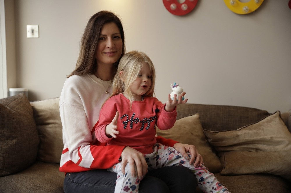 Victoria Mickleburgh and her daughter Grace pose for photographs at their home. Things are already tough for Mickleburgh, whose 3-year-old daughter Grace, has Type 1 diabetes and needs insulin daily, Cobham, London, Jan. 23, 2019.