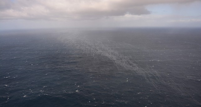 This handout picture taken and released by the French Navy on March 14, 2019, shows an oil sheet in the ocean after the Italian cargo ship Grande America burned and sank in the Gascogne Gulf, off the western French coast. (AFP Photo)