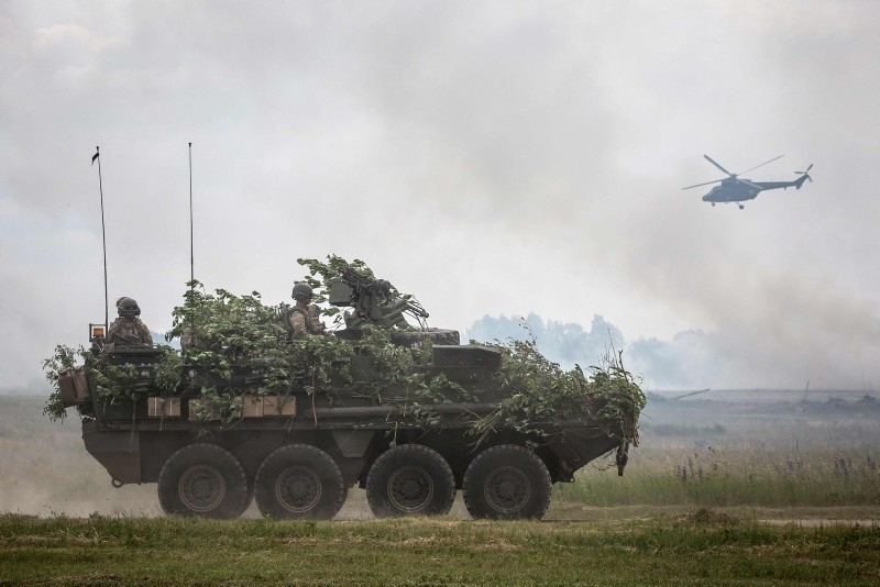 In this file photo taken on June 16, 2017 NATO troops are seen during NATO Saber Strike military exercises  in Orzysz, Poland. (AFP Photo)