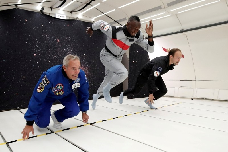 Retired sprinter Usain Bolt, French astronaut Jean-Francois Clervoy and French Interior designer Octave de Gaulle enjoy zero gravity conditions during a flight in a specially-modified Airbus Zero-G plane above France, Sept. 12, 2018. (REUTERS Photo)