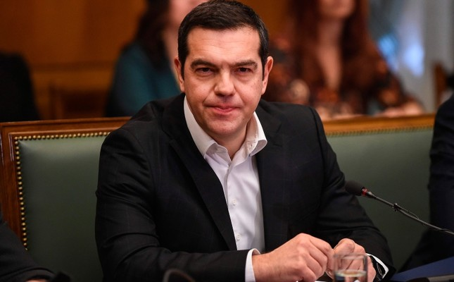 Greek Prime Minister Alexis Tsipras reacts as he attends a cabinet meeting at the parliament in Athens, on January 28, 2019 (AFP Photo)