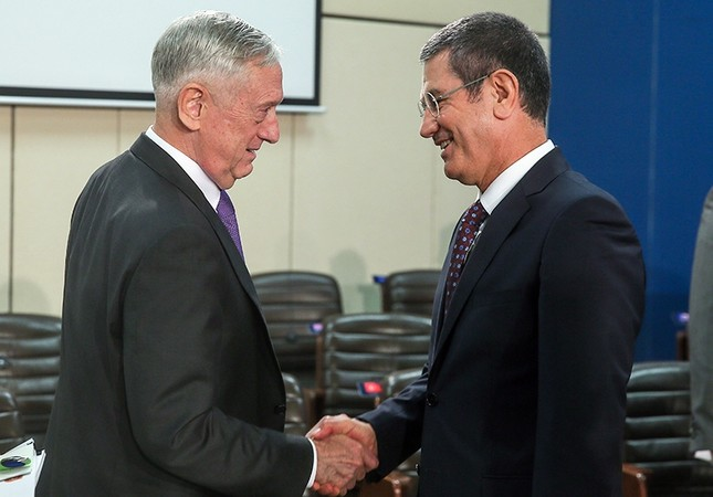 Turkey's Defense Minister Nurettin Canikli (Right) shakes hands with U.S. Secretary of Defense Jim Mattis in Brussels, Wed. Nov.8, 2017 (EPA Photo)