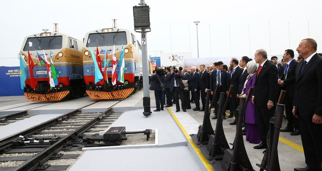 Erdoğan (2nd R), accompanied by first lady Emine Erdoğan (3rd R), Azerbaijan's Aliyev (R), Kazakh, Uzbek and Georgian leaders and their delegations look at trains during the inauguration ceremony of the Baku-Tbilisi-Kars Railway, Baku, Oct. 30.
