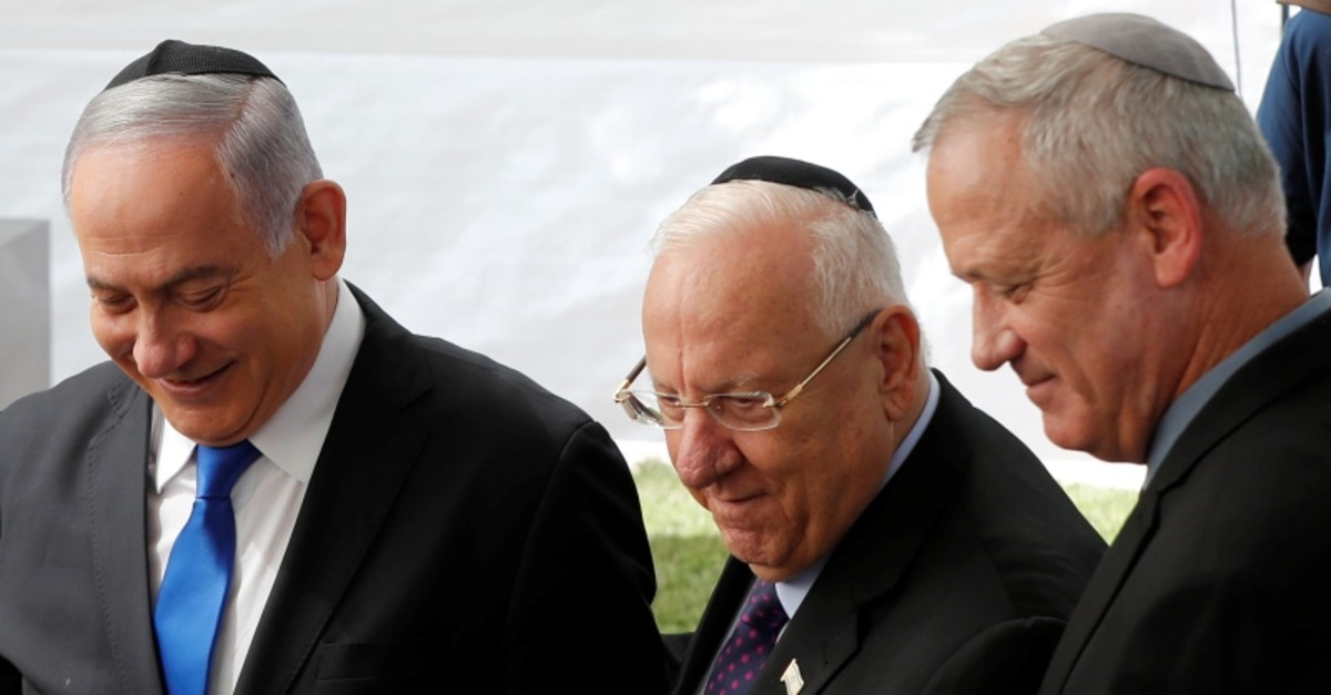 Israeli PM Benjamin Netanyahu (L), President Reuven Rivlin and Benny Gantz, leader of Blue and White party, stand next to each other at a memorial ceremony for late President Shimon Peres, at Mount Herzl in Jerusalem, Sep. 19, 2019. (Reuters Photo)