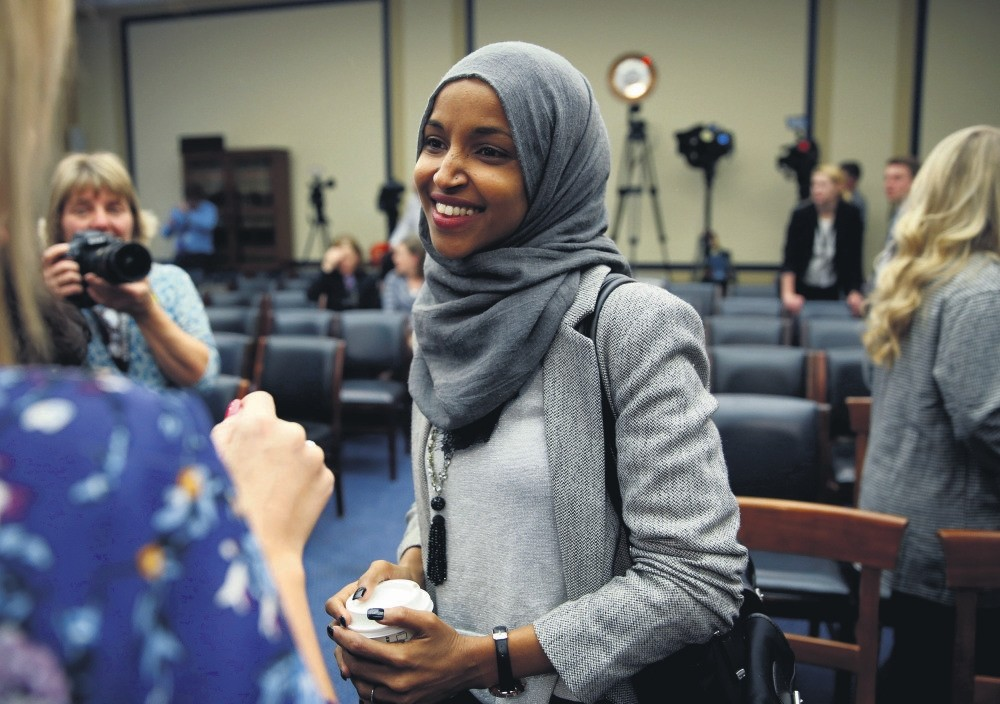 Representative-elect Ilhan Omar speaks to the media after a lottery for office assignments on Capitol Hill in Washington, Nov. 30.