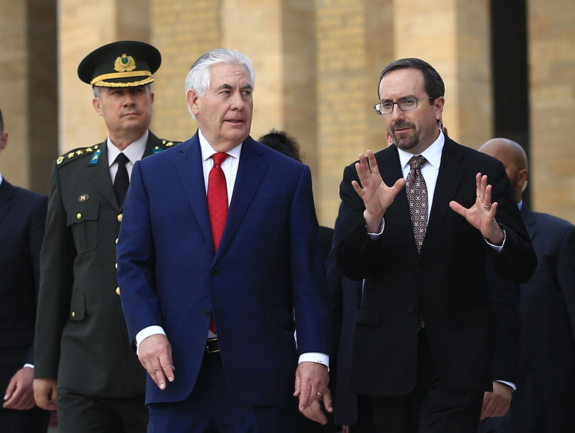 U.S. Ambassador John Bass (R) talks to U.S. Secretary of State Rex Tillerson (L) during a visit in Ankara, March 30.