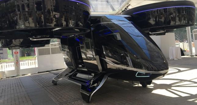 """The Bell Nexus concept """"flying car"""" is shown at the Uber Elevate summit in Washington, DC on June 11, 2019, one of several that will make up a fleet of electric aircraft Uber expects to deploy by 2023. (AFP Photo)"""