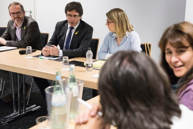 VP of the Catalonia's parliament Josep Costa (L), former Catalan president Carles Puigdemont (2-L) and Catalonia JxCat party spokesperson, Elsa Artadi (2-R) are seen prior to a work meeting with members of their parliamentary group (EPA Photo)