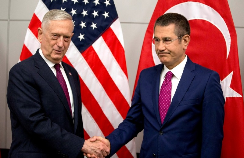 US Secretary of Defence James Mattis (L) shakes hands with Turkish Defence Minister Nurettin Canikli prior to a meeting of NATO defense ministers at the NATO headquarters in Brussels. (AFP Photo)