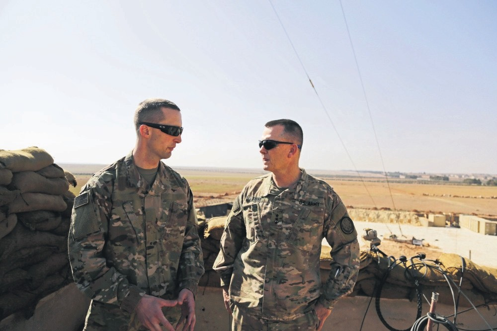 U.S. Army Capt. Timothy Skinner (L) and Lt. Gen. Paul E. Funk consult at a U.S. outpost near the YPG-held town of Manbij, Syria, Feb. 7.