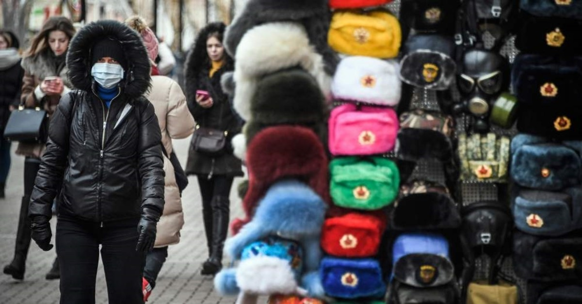 People walk along Arbat pedestrian street in downtown Moscow, Feb. 19, 2020. (AFP Photo)