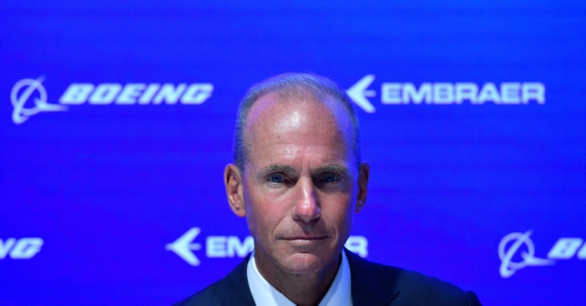 In this file photo taken on July 16, 2018 Boeing CEO, Dennis Muilenburg gestures during an event at the Farnborough Airshow, south west of London