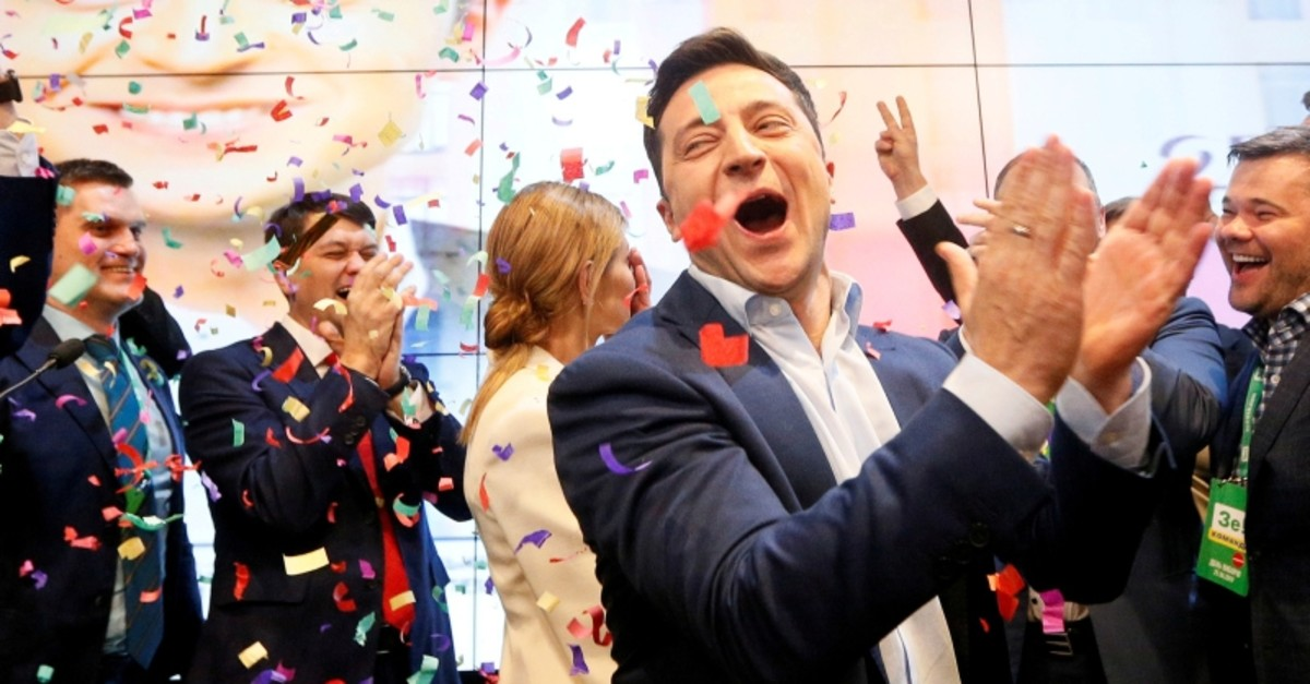 Ukrainian presidential candidate Volodymyr Zelenskiy reacts following the announcement of the first exit poll in a presidential election at his campaign headquarters in Kiev, Ukraine April 21, 2019. (Reuters Photo)