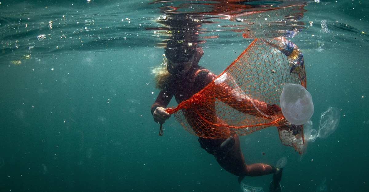 u015eahika Ercu00fcmen, a world record-holding diver, collects garbage underwater during the launch of the Zero Waste Blue project by Emine Erdou011fan in Istanbul, June 11, 2019.