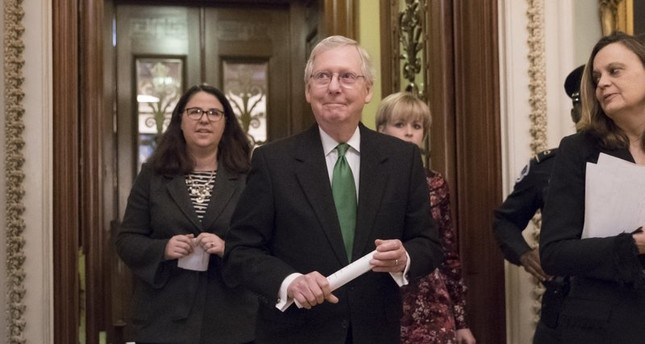 Senate Maj. Leader Mitch McConnell, R-Ky, leaves the chamber after announcing an agreement in the Senate on a 2-year, almost $400 BN budget deal that would provide Pentagon and domestic programs with huge spending increases, at the Capitol (AP Photo)