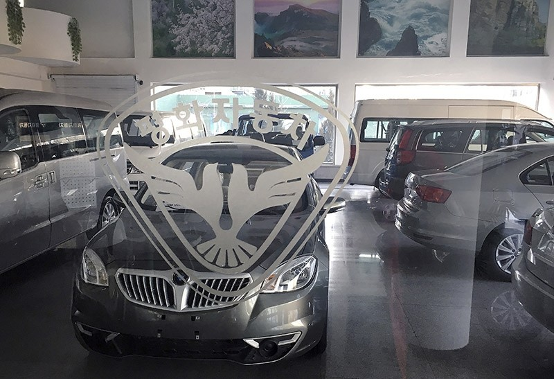 In this Tuesday, Jan. 10, 2017, photo, the double-pigeon logo of Pyonghwa Motors is seen on the glass of the Pyonghwa Motors car showroom in Pyongyang, North Korea. (AP Photo)