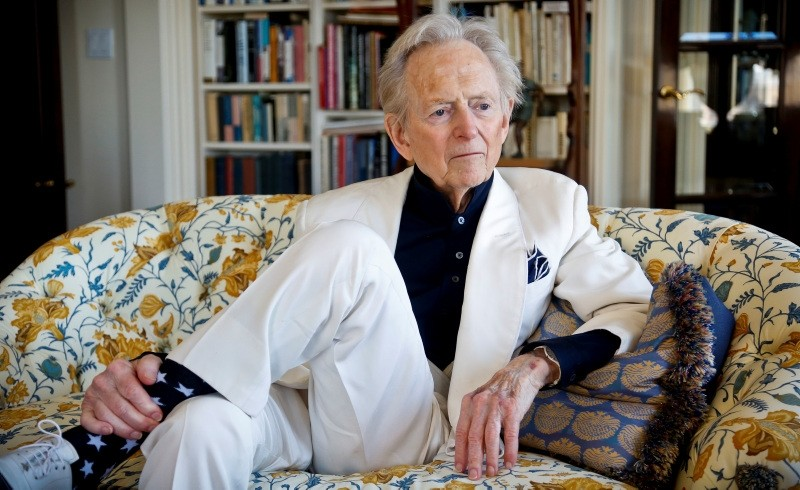 American author and journalist Tom Wolfe, Jr. appears in his living room during an interview about his latest book, ,The Kingdom of Speech,, in New York. (AP Photo)