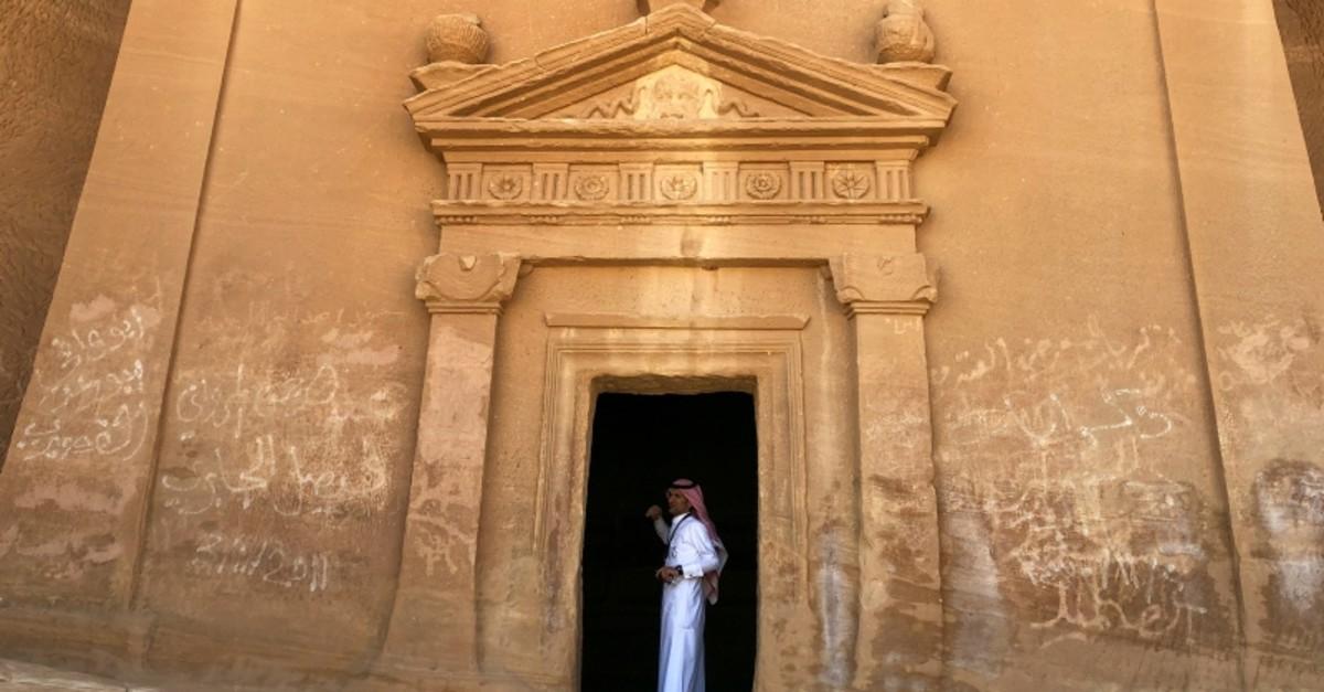 A Saudi tour guide stands inside a tomb at Madain Saleh antiquities site, al-Ula, Saudi Arabia February 10, 2019. (REUTERS Photo)