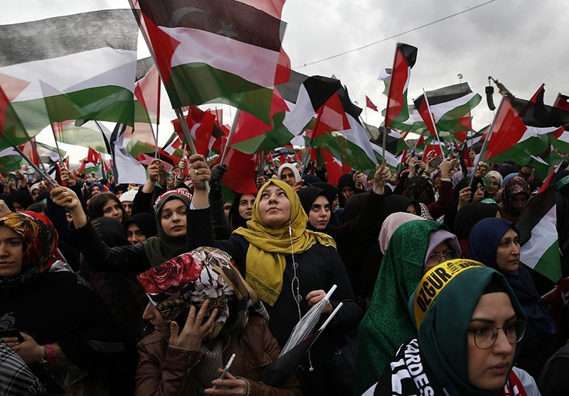 Protesters, holding Turkish and Palestinian flags, participate in a rally against U.S. President Donald Trump's decision to recognise Jerusalem at the capital of Israel, in Istanbul, Sunday, Dec. 10, 2017. (AP Photo)