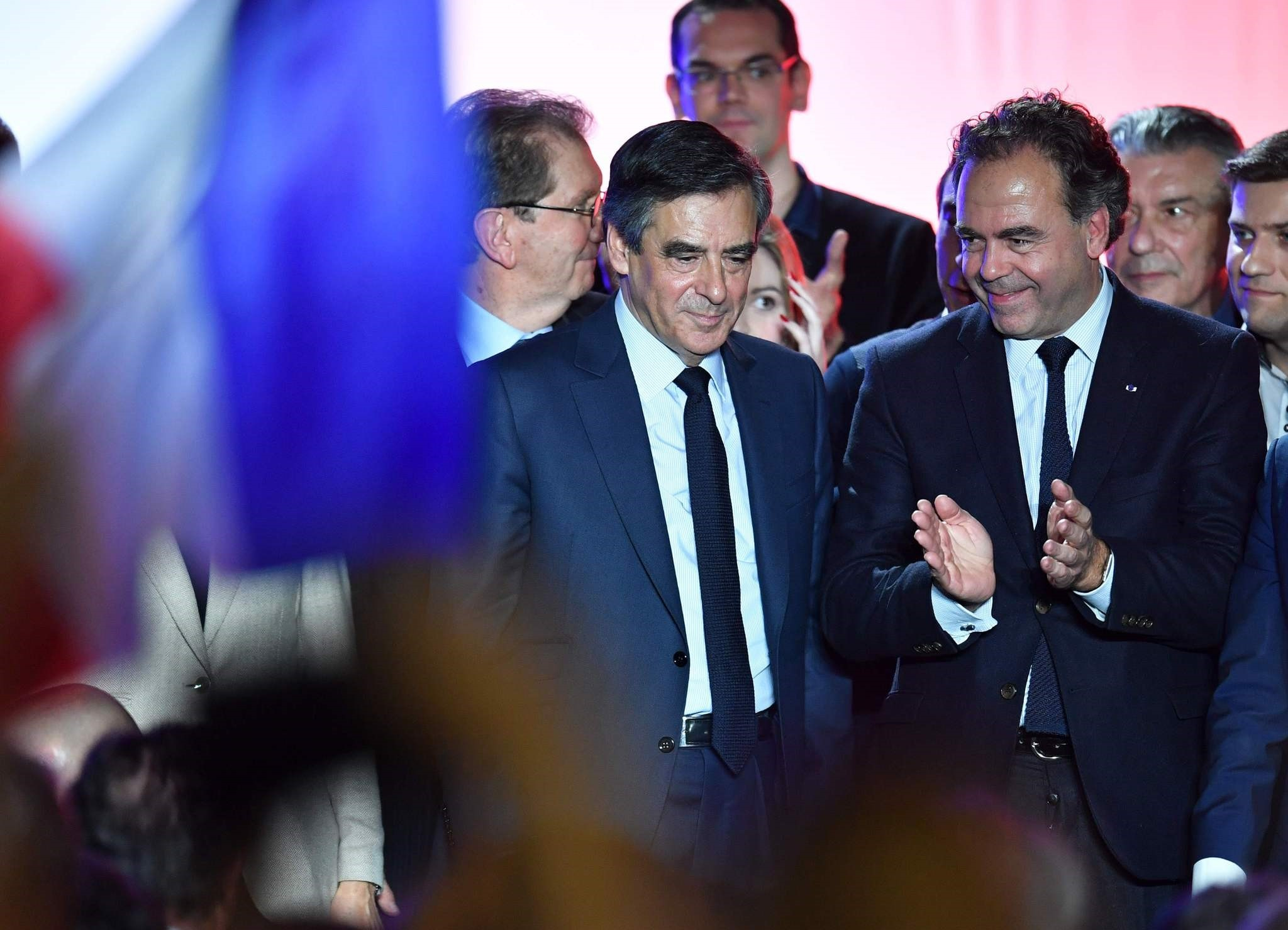 Francois Fillon (L) flanked by French lawmaker Luc Chatel(R) react on March 2, 2017 during a campaign rally on March 2, 2017 in Nu00eemes, southern France. (AFP Photo)