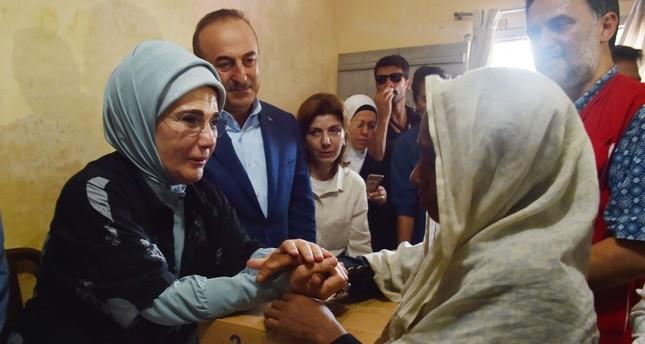 First Lady Emine Erdoğan, left, and Foreign Minister Mevlüt Çavuşoğlu, second from left, give out aid boxes during their visit to the Kutupalong Refugee Camp, which is home to Rohingya Muslims who fled from Myanmar in Cox's Bazar, Sept. 7.