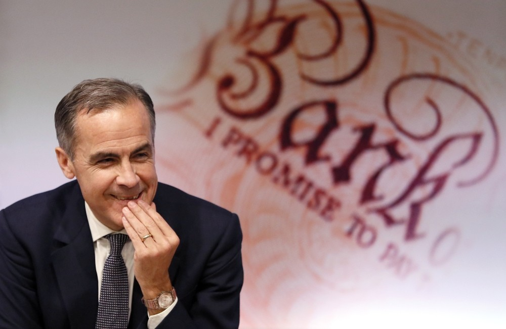 Mark Carney, Governor of the Bank of England smiles at a quarterly Inflation Report press conference at the bank in London Thursday.