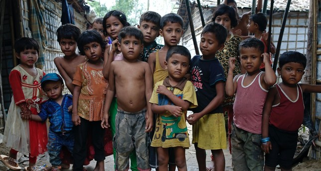 A group of Rohingya refugee children stand at a makeshift camp, Cox's Bazar, Aug. 24.