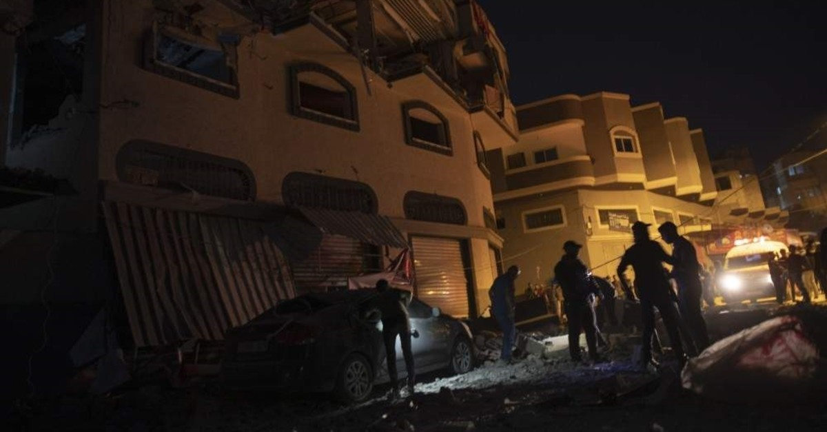 Palestinians check the damage of a house targeted by Israeli missile strikes in Gaza City, Tuesday, Nov. 12, 2019. (AP Photo)