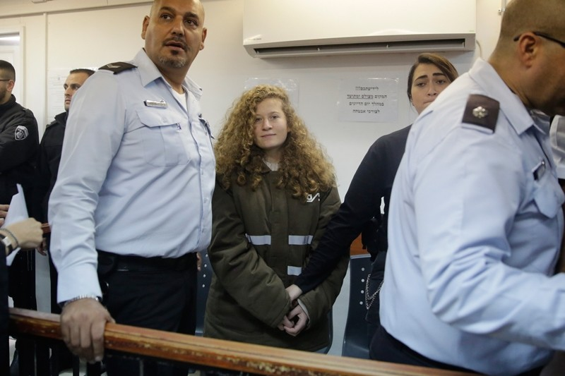 Ahed Tamimi is brought to a courtroom inside the Ofer military prison near Jerusalem, Monday, Jan. 15, 2018 (AP Photo)