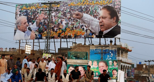 Deposed Pakistani Prime Minister Nawaz Sharif, center, addresses his supporters during a rally in Jhelum, Pakistan, Thursday, Aug. 10, 2017. AP Photo