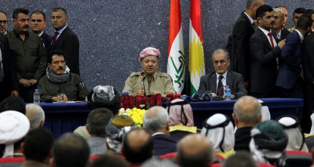 KRG leader Masoud Barzani sits with Kirkuk Governor Najmaldin Karim, right, during his visit in Kirkuk, Sept. 12.