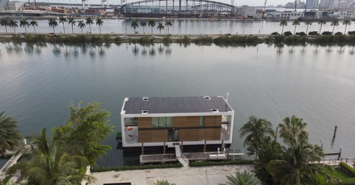 An aerial view from a drone shows the Arkup houseboat, a green-energy luxury floating home that can allow owners to adapt as the sea level continues to rise on May 14, 2019 (AFP Photo)