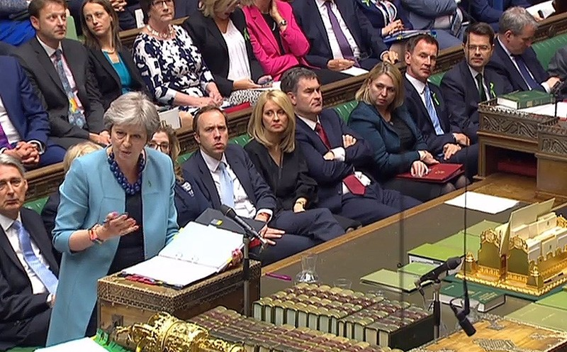 A video grab from footage broadcast by the UK Parliament's Parliamentary Recording Unit (PRU) shows Britain's Prime Minister Theresa May as she speaks during Prime Minister's Questions (PMQs) in the House of Commons on May 16, 2018. (AFP Photo)