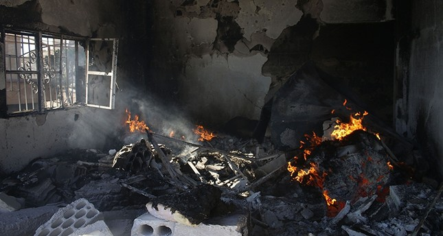 A house is set on fire during an airstrike by Syrian regime forces on the town of Busra al-Harir in the east of the southern Syrian province of Daraa on June 24, 2018. (AFP Photo)