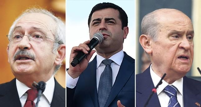 Main opposition CHP chairman Kemal Kılıçdaroğlu (L), pro-PKK HDP co-chair Selahattin Demirtaş (C) and nationalist MHP chairman Devlet Bahçeli