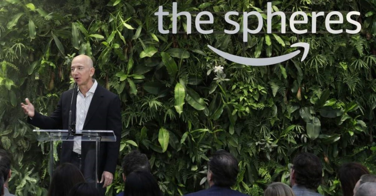 In this Monday, Jan. 29, 2018, file photo, Jeff Bezos, the CEO and founder of Amazon.com, speaks during the grand opening of the Amazon Spheres in Seattle. (AP Photo)