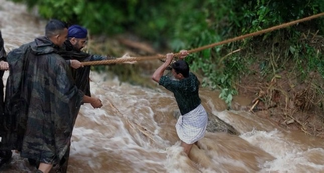 A handout photo by Indian Defense Ministry shows Indian military personnel conducting rescue operations in the flood affected areas in Belgaum/Belagavi district in North Karnataka, India, Aug. 10, 2019. (AP Photo)