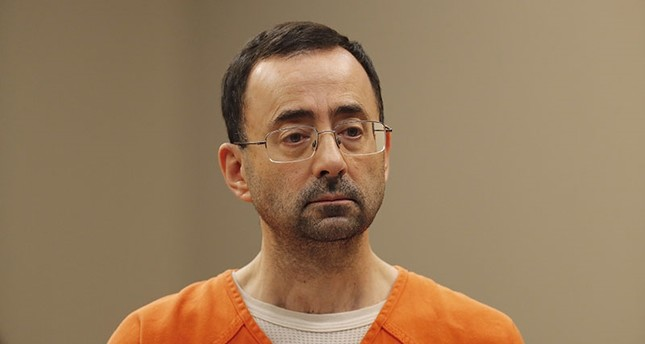 Dr. Larry Nassar, 54, appears in court for a plea hearing in Lansing, Mich. (AP Photo)