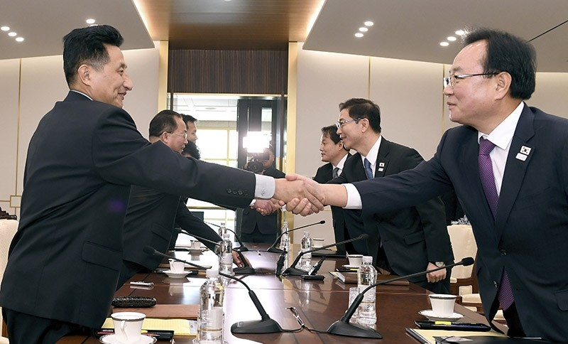 In this photo provided by South Korea Unification Ministry, South Korean Vice Unification Minister Chun Hae-sung, center right, shakes hands with the head of North Korean delegation Jon Jong Su in Paju, South Korea, Jan. 17, 2018. (AP Photo)